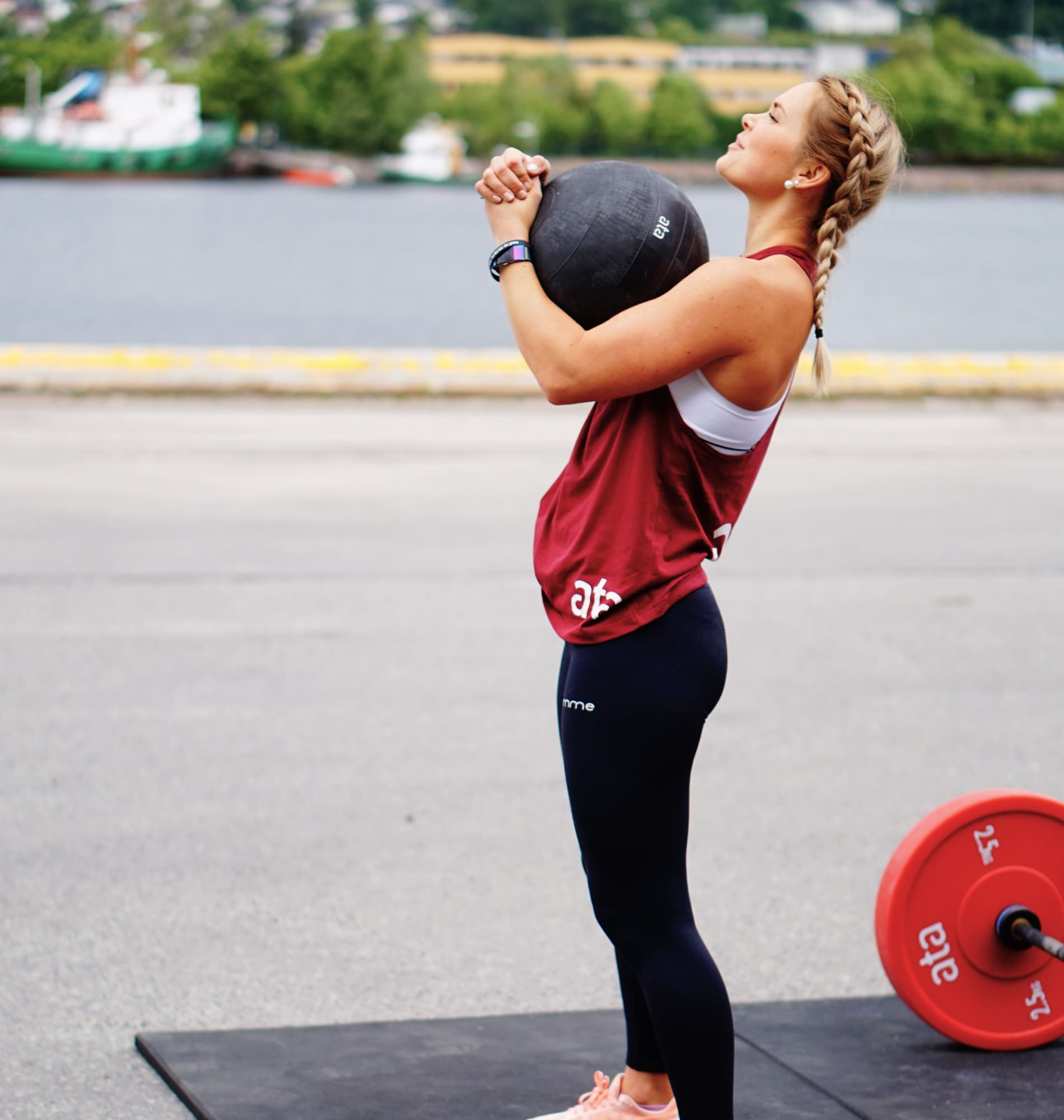 Woman lifting medicine ball