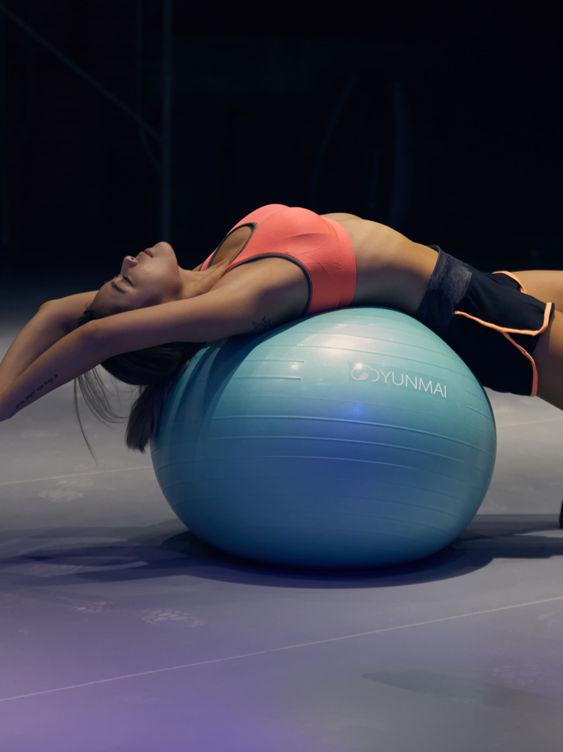 Girl stretching on a ball